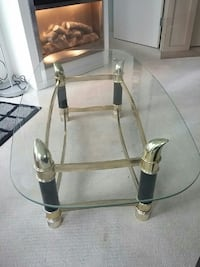 stainless steel framed glass top coffee table