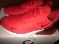 Pair of red nike running shoes Murfreesboro, 37130