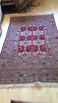 red, white, and brown floral area rug 26 mi