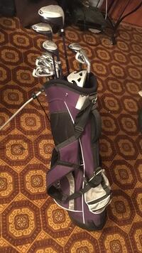 purple and black golf bag with stainless steel golf club set Winnipeg, R2J 1V7