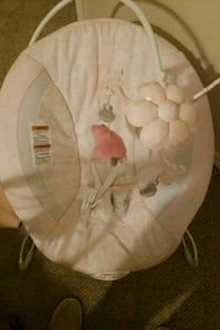 baby's white and pink bouncer Laredo
