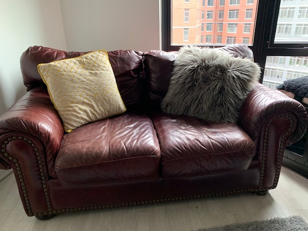 Brown leather coach and loveseat set