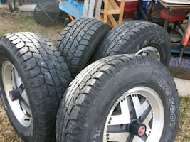 four black auto wheels with tires