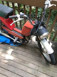Red and black moped, does not run needs carb cleaned or replaced.
