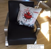 Chair comfy comfy.....designer black leather with stainless steel arms and legs..EUC. MOVING Calgary, T2L 0T3