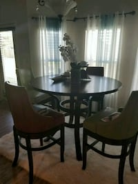 round brown wooden table with four chairs dining set McDonough, 30253