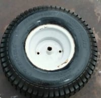 white bullet hole vehicle wheel and tire 2216 mi