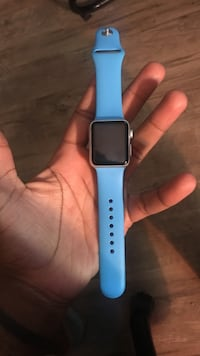 Silver aluminum case apple watch with blue sports band