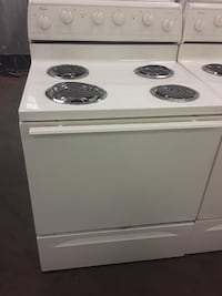 white Whirlpool electric coil range oven