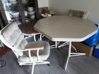 dinning room table with 4 chair s.