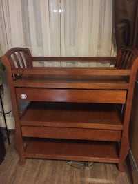 Brown Wooden changing table with a storage
