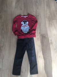 Red penguin graphic sweater with black denim jeans Herndon
