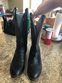 pair of black leather r-toe cowboy boots