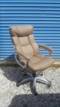 brown leather padded rolling armchair Morehead City