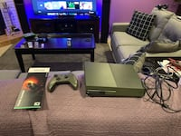 black Xbox One with controller and game cases 683 mi