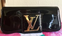 Brown and gold-colored LV clutch New York, 11432