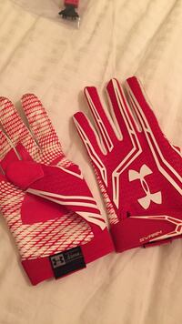 red-and-white Under Armour gloves