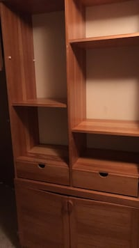 Brown wooden cabinet with shelf