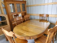 solid Oak dinning room table, hutch, and 6 chairs  Plainfield, 46168