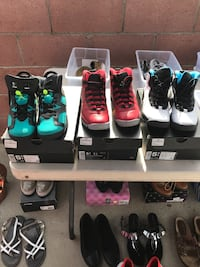 three pairs of assorted Air Jordan basketball shoes with boxes