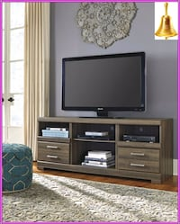 black flat screen TV; brown wooden TV stand Katy