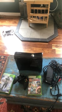Black xbox 360 with controller and game cases Martinsburg, 25404