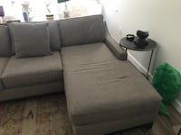 gray fabric sectional sofa with ottoman null