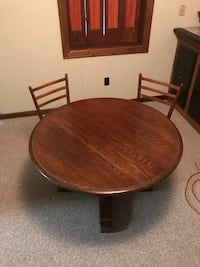 Wood table with 2 wicker chairs