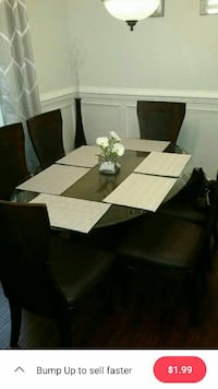 rectangular white wooden table with chairs