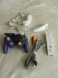 two black and one white Nintendo Wii controllers Markham, L6B 0B4