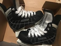 pair of black-and-silver Challenger hockey skates with box