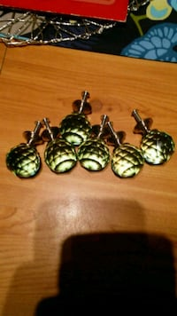 6 new green glass knobs.  Elyria, 44035