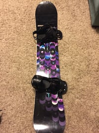 black and purple snowboard with bindings Calgary, T3M 1S7