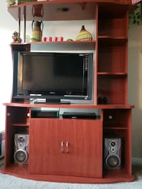 flat screen television and brown wooden TV hutch Silver Spring, 20903