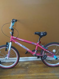 pink and white BMX bicycle