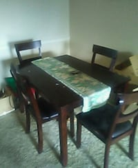 rectangular brown wooden table with chairs dining set Bradenton, 34209