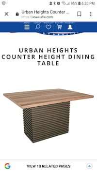 brown wooden table with black metal base Mesa, 85210