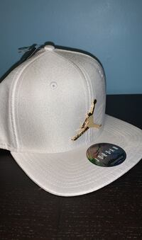 White and gold Jordan hat