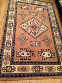 Brown and white floral print area rug