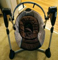 Brown Graco Baby Swing