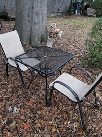 black square patio table with 2 chairs