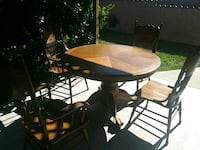 round brown wooden table with four chairs Diamond Bar, 91765