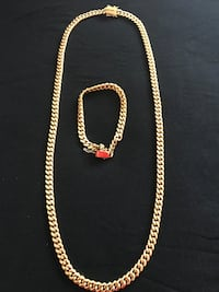 Gold-colored chain-link necklace with bracelet set