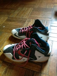 pair of white-and-black Nike basketball shoes 46 km