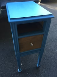 Side table missing the top drawer. I have extra paint in that color if needed.