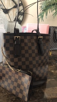 Petit Bucket tote shoulder handbag pre-owened but looks good ....with code ....I only sell Authintic  Houston, 77073
