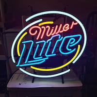 Blue, red, and yellow Miller Lite neon light signage