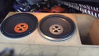 two black-and-red subwoofers 1022 mi