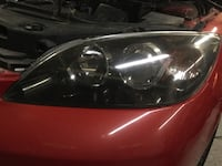 Black and red car headlight