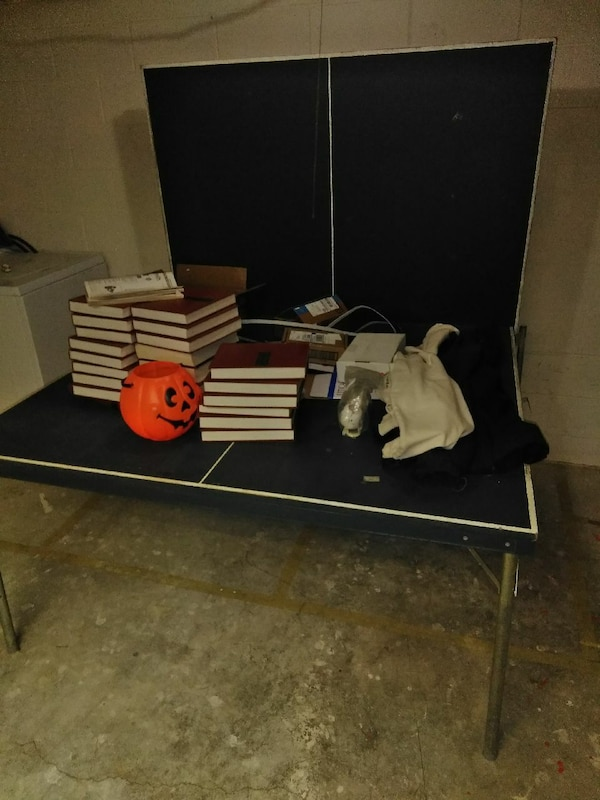 Ping pong table and set of encyclopedias